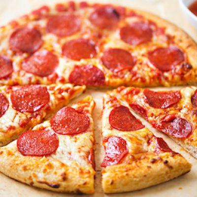 Default_9b4106b8f65359684b3836096b4524c8_pizza_dreamstimesmall_94940296
